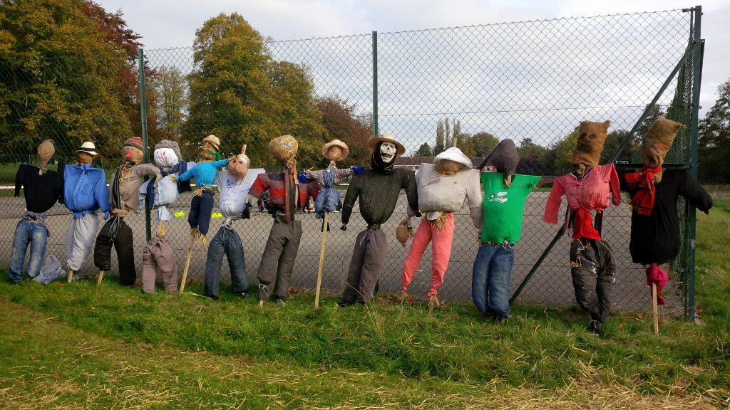 Scarecrow making event  October 2016. Scarecrows lined up by the tennis court fence.